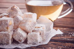 Turkish delight lokum with tea Royalty Free Stock Image