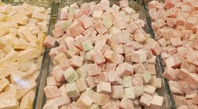 Turkish delight or lokum. Is a family of confections based on a gel of starch and sugar. The confection is often packaged and eaten in small cubes dusted with stock photo