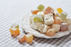 Turkish delight. With nuts on checkered tablecloth closeup stock photos
