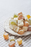 Turkish delight. With nuts on checkered tablecloth closeup Stock Images