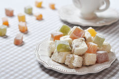 Turkish delight. With nuts on checkered tablecloth closeup Stock Photo