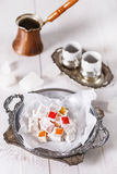 Turkish Delight over white wooden background Stock Photos