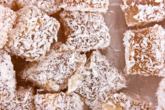 Turkish delight. Pieces of dainties the Turkish delight with the coconut shaving stock photos