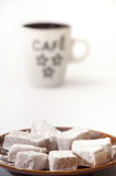 Turkish delight on a plate and a cup of brewed coffee Stock Image