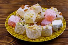 Turkish delight in a plate on wooden table. Turkish delight in a plate on a wooden table royalty free stock photo
