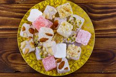 Turkish delight in a plate on wooden table. Turkish delight in a plate on a wooden table stock image