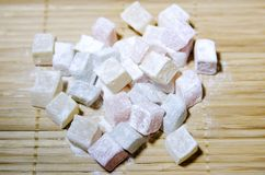 Turkish Delight in powdered sugar. Close-up, selective focus. Turkish Delight in powdered sugar. Closeup, selective focus stock photography