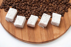 Turkish Delight with powdered sugar on a kitchen wooden board wi Stock Image