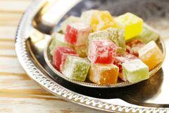 Turkish delight rahat loachum. Colorful sweet Turkish delight in the traditional dishes Royalty Free Stock Image