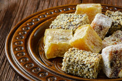Turkish delight or rahat lokum on wooden plate Stock Photo