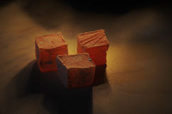 Turkish Delight. Rose flavoured turkish delight under soft candle light stock photos