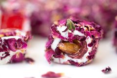 Turkish delight with rose, lokum. Turkish delight with rose petals, lokum stock photography