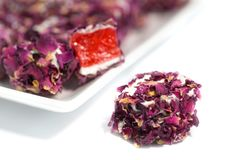Turkish delight with rose, lokum. Turkish delight with rose petals, lokum royalty free stock photos