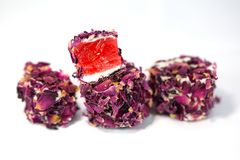 Turkish delight with rose, lokum. Turkish delight with rose petals, lokum royalty free stock image
