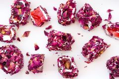 Turkish delight with rose, lokum. Turkish delight with rose petals, lokum royalty free stock photo