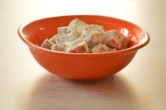 Turkish delight on the table. Turkish delight in orange bowl on the table royalty free stock photo