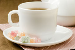 Turkish delight with tea on a saucer. Breakfast concept Stock Photography