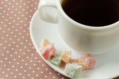 Turkish delight with tea on a saucer. Breakfast concept Royalty Free Stock Photos