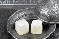 Turkish delight in traditional Ottoman style carved patterned metal plate Stock Photos