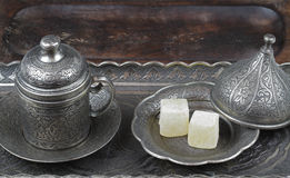 Turkish delight in traditional Ottoman style carved patterned metal plate and coffee cup Stock Image