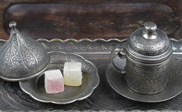 Turkish delight in traditional Ottoman style carved patterned metal plate and coffee cup Royalty Free Stock Image