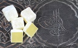 Turkish delight in traditional Ottoman Sultans Tugra carved patterned metal plate Stock Photography