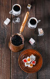 Turkish Delight and Turkish coffee over dark wooden background Stock Photography