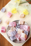 Turkish delight. Of varicoloured pieces, in a saucer stock photos