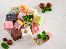 Turkish delight on white rustic background Stock Images