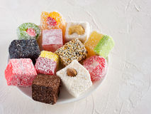 Turkish delight on white rustic background Royalty Free Stock Photo