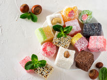 Turkish delight on white rustic background Stock Photography