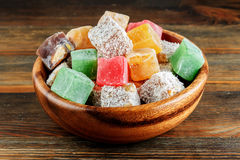 Turkish delight in a wooden bowl Royalty Free Stock Photo