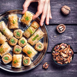 Turkish delights baklava on wooden table Stock Photos