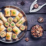 Turkish delights baklava on wooden table Stock Photography