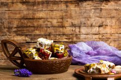 Turkish delights with pistachios and rose flower stock image
