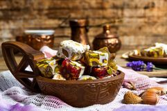 Turkish delights with pistachios and rose flower royalty free stock photography