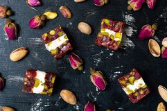 Turkish delights with pistachios and rose flower stock photo
