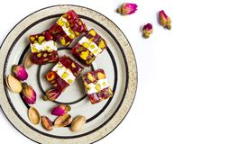 Turkish delights with pistachios and rose stock photography