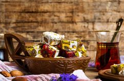 Turkish delights with pistachios and tea. Turkish delights with pistachios and Arabic tea dessert cup glass drink cube snack rahat lokum rose flower table plate stock images