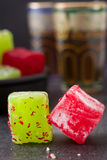 Turkish delights and tea on black slate background Stock Photography
