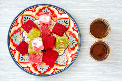 Turkish delights and tea on blue background Royalty Free Stock Photo