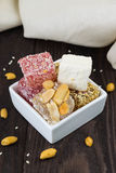 Turkish delights in white bowl Stock Photos