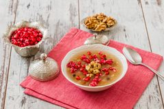 Turkish Dessert Ashura. Noah's pudding, with pomegranate seeds and walnuts Royalty Free Stock Photos