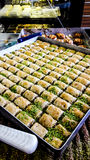 Turkish dessert baklava with pistachio powder. Royalty Free Stock Photos