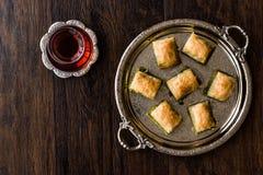 Turkish Dessert Baklava with tea on silver tray. Stock Image