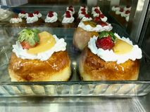 Turkish Dessert Balli Baba / Honey Cakes with Whipped Cream and Sherbet at Patisserie Showcase. Traditional Dessert stock images