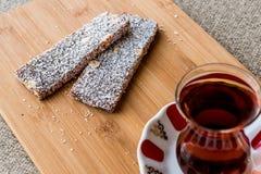 Turkish Dessert Cezerye with walnut, coconut powder and tea Royalty Free Stock Photos