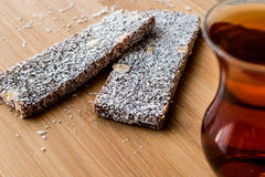 Turkish Dessert Cezerye with walnut, coconut powder and tea Stock Photography