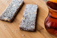 Turkish Dessert Cezerye with walnut, coconut powder and tea Royalty Free Stock Images