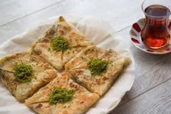 Free Turkish Dessert Katmer With Pistachio Powder And Tea Royalty Free Stock Photos - 77929328